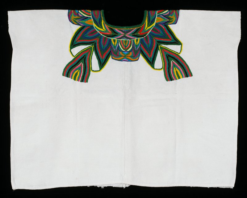 white background with embroidered neckline decoration in abstracted foliage pattern in deep green, blue, pink, yellow, black, and turquoise.