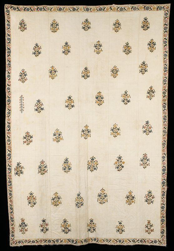 Cream background with embroidered floral groups widely spaced; blue, green, mauve, ochre, orange.