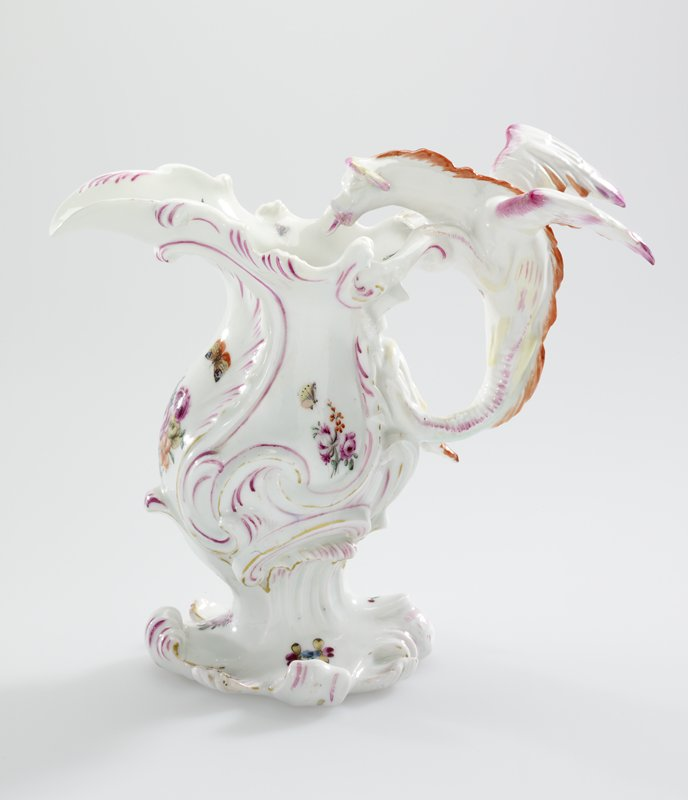 white with floral decoration; winged dragon as handle