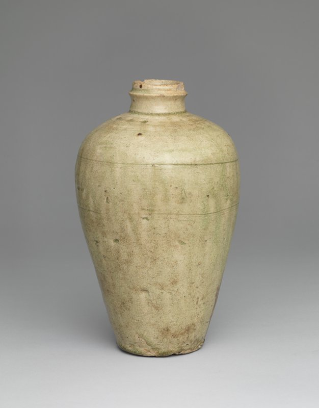 jar with narrow base, wide shoulder, narrow neck, and incised lip; concentric incised lines around neck, shoulder, and portion of center; light greenish glaze