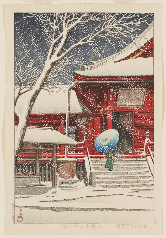 figure behind blue umbrella on steps of red temple; snowing with snow-covered tree on L
