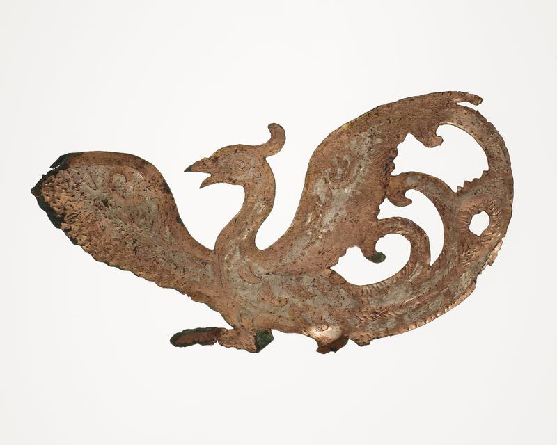 flying bird with outstretched wings, facing L; mounted on black cloth-covered board with L2003.116.8.2-3
