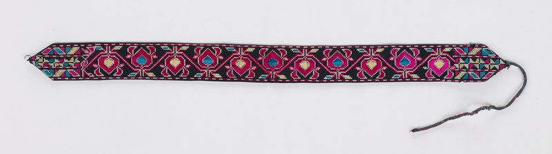 black background; dark pink, white, yellow and turquoise embroidered foliate and organic designs; white stitching on back