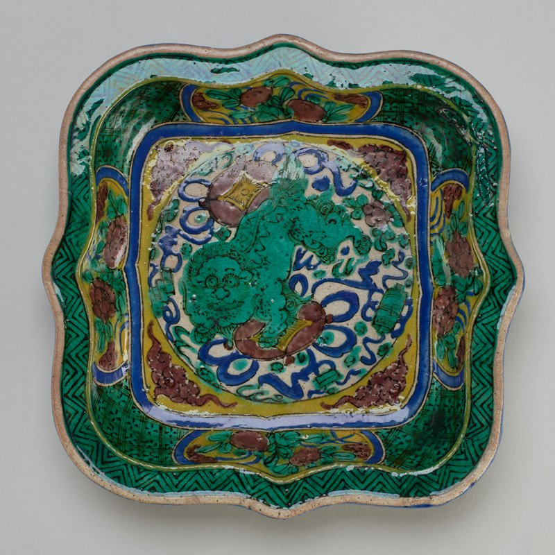 Pair of porcelain plates, foo dog motif; lilac and green