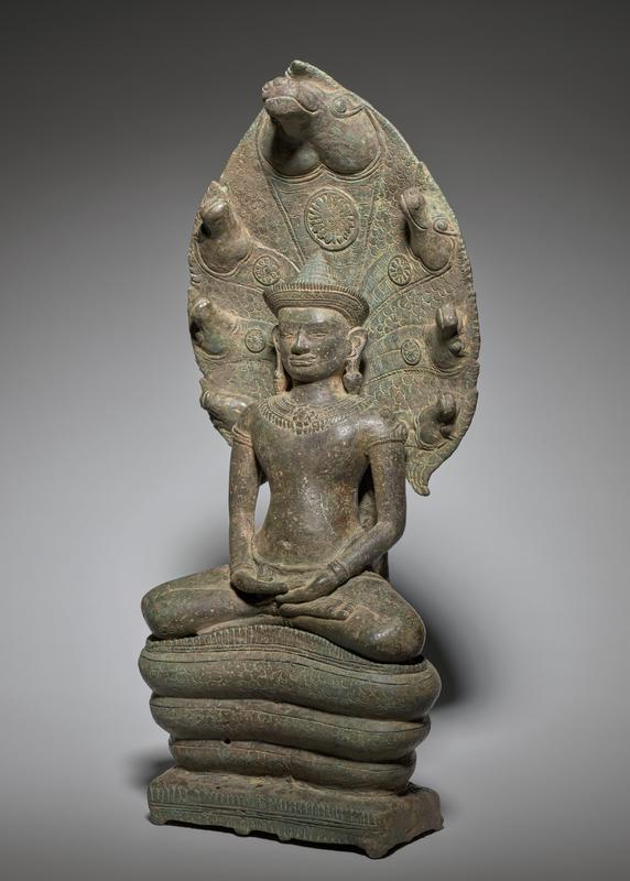 seated Buddha with hands in lap; wearing necklace, bracelets, earrings and hatlike crown; coiled snake body throne; 7 horselike heads on back of throne, each with a floral medallion under chin