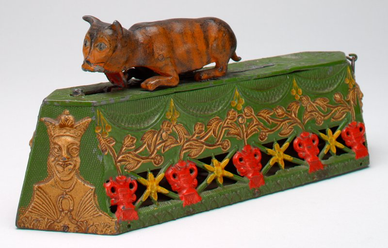 green, gold, yellow and red openwork base with 4 kings (?), flowers and cherries; orange cat pounces on small mouse-like animal
