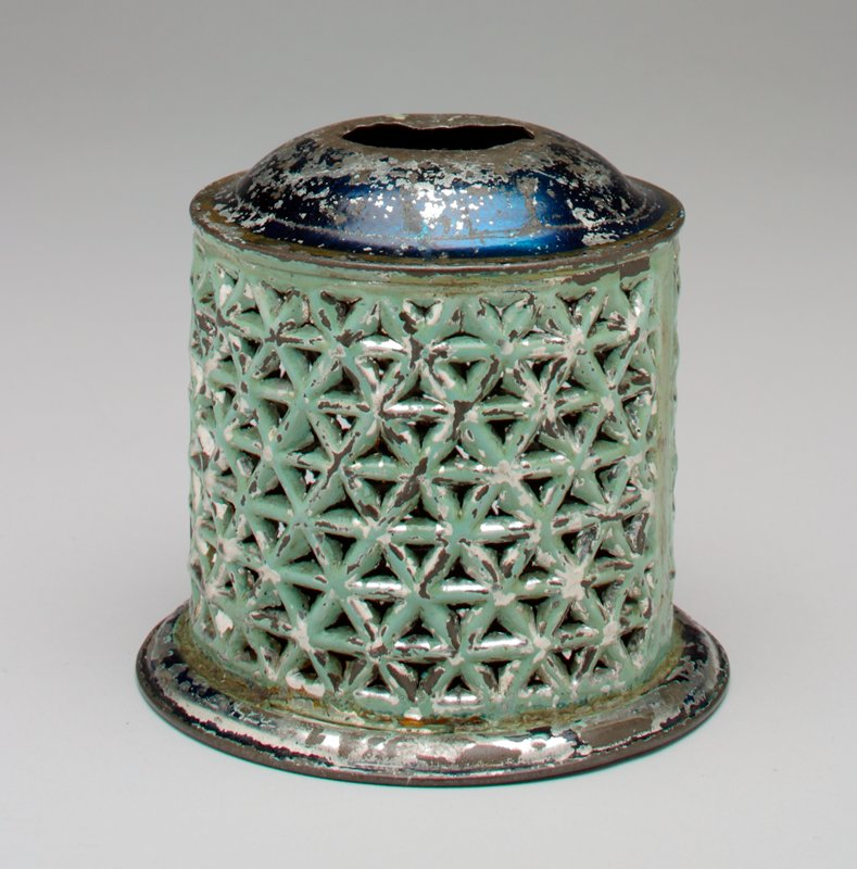 cylindraical openwork body in turquoise; shiny blue top and base