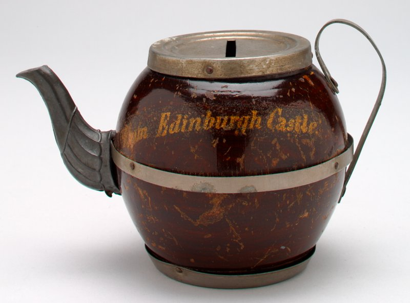 "teapot-shaped bank with wood body and metal handle, top, spout and bands; ""From Edinburg Castle"" on front of teapot"