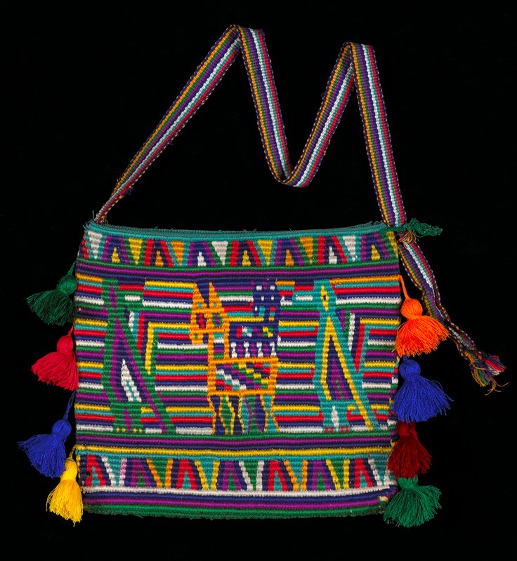 Knitted bag in multi-colored stripes, geometric and zoomorphic (horse, birds) pattern. 4 tassels at each side.