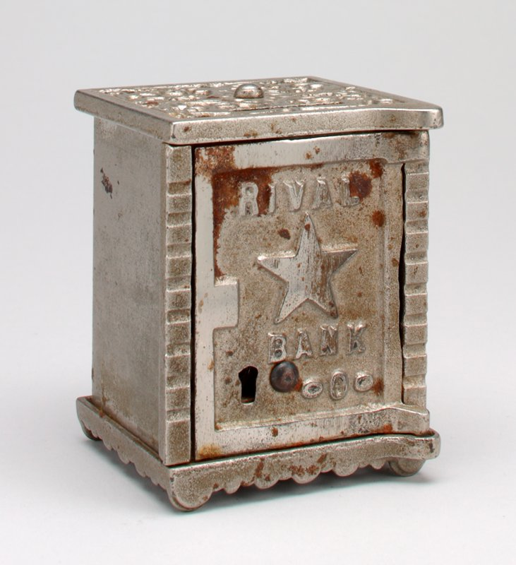 slot bank in the form of a safe with solid sides; top and bottom in cast grillwork