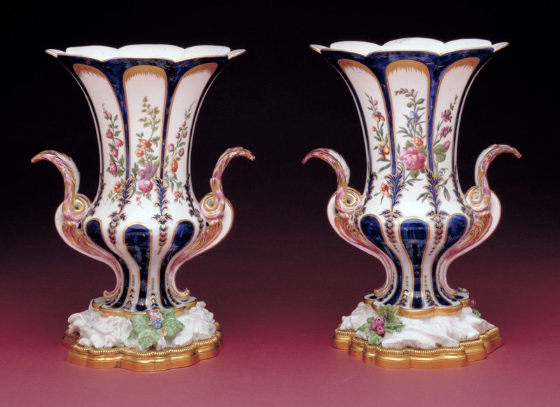 vase, ceramic-porcelain, gilded bronze; NO DIMS ON CAT. CARDS; cat. card dims H 10-1/4 x W 7-1/2; decorated on both faces with floral branches; handles in the shape of volutes