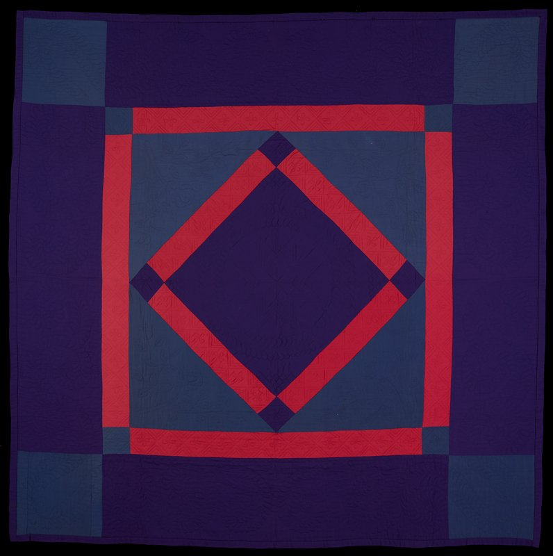 central diamond pattern; purple borders with blue corner blocks and feather wreath quilting; narrower inner border of pinkish-red with blue corner blocks and pinwheel and stacked triangles; inner diamond of purple with eight-pointed quilted star bordered with another pinkish-red band with purple corners quilted with pinwheels and stacked triangles; blue triangles at sides of inner diamond with quilting of roses at one end and tulips at other end; purple wool edge binding; cotton cloth on back with red clover and dot print on black-red ground