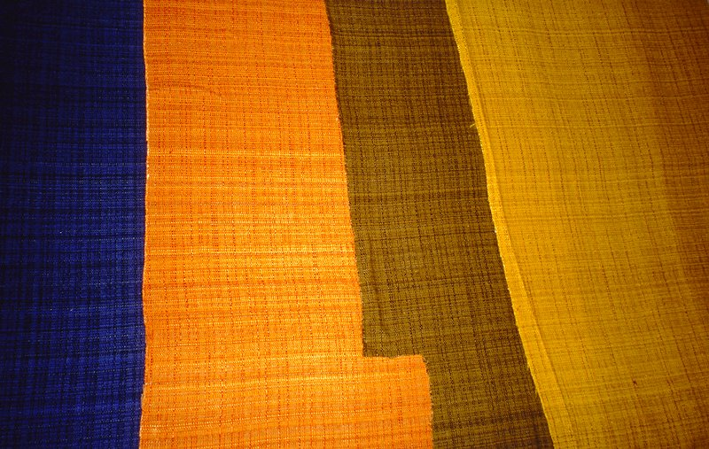 Variation on a plain weave:some thin and thick warp. Over dyed fabric. Dark Olive