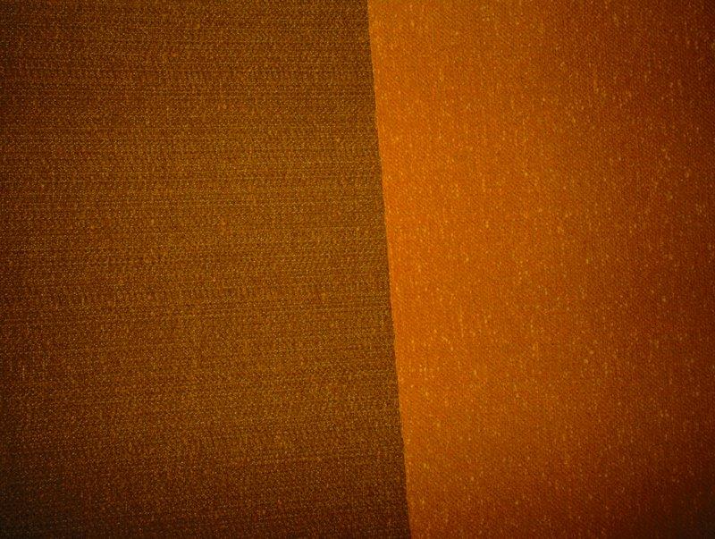 Plain weave. Thin gray warp. Thick weft, random shots using two weft threads. Mothproofed, scotchguard finish. Backed with acrylic latex. Plain weave. Thin gray warp. Thick weft, random shots using two weft threads. Mothproofed, scotchguard finish. Backed with acrylic latex. Carnelian Gold