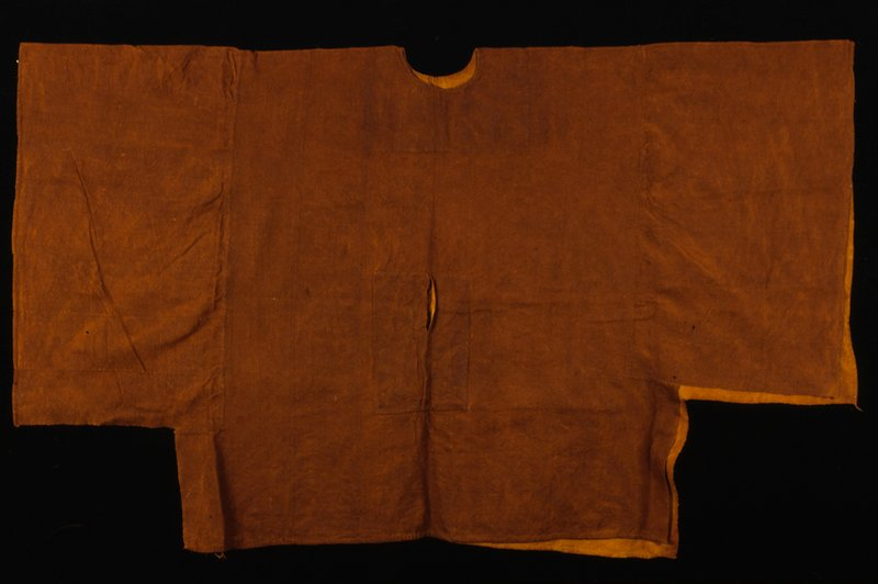 cotton, strip-woven dyed red from bark of Gollobe tree; red color represents blood and a particular cow (nage woderu); shirt worn by wealthy Fulani on important feast days; stored w/86.100.18,.20,.28,.29