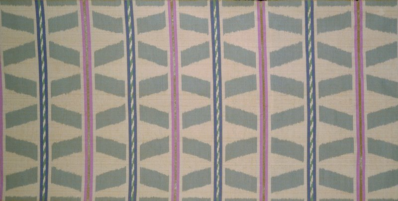 """A bold geometry is rendered opulent with a melange of pastels and a finely guimped gold metallic. Handwoven Ikat from Thailand. 3"""" Wide diagonals in grey, separated by 2"""" bands alternating small blue/green diagonals & metallis/lilac strips. 15"""" rpt. Fire Opal"""