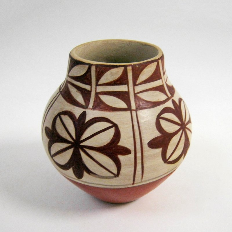small, concave base, flaring outward and inward to wide mouth; thick walls; decorated with 4 repeating organic flower motifs at shoulder and 8 repeating organic leaf motifs at rim; red and cream