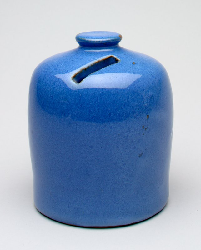 blue cylinder shape; knob top; coin slot in top