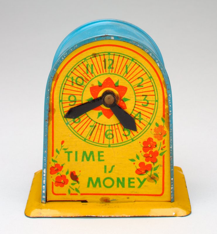 blue and yellow clock shape bank; clock face on one side, coin slot on the other; drawing of a child with dolls and buggy below slot, red flowers above;