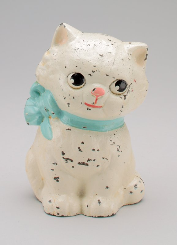 seated white cat with light blue bow around neck; coin slot in bow at back of neck