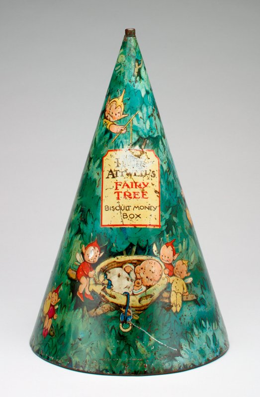 green cone-shaped tree with birds, fairies and a baby in a cradle; coin slot in back next to seam