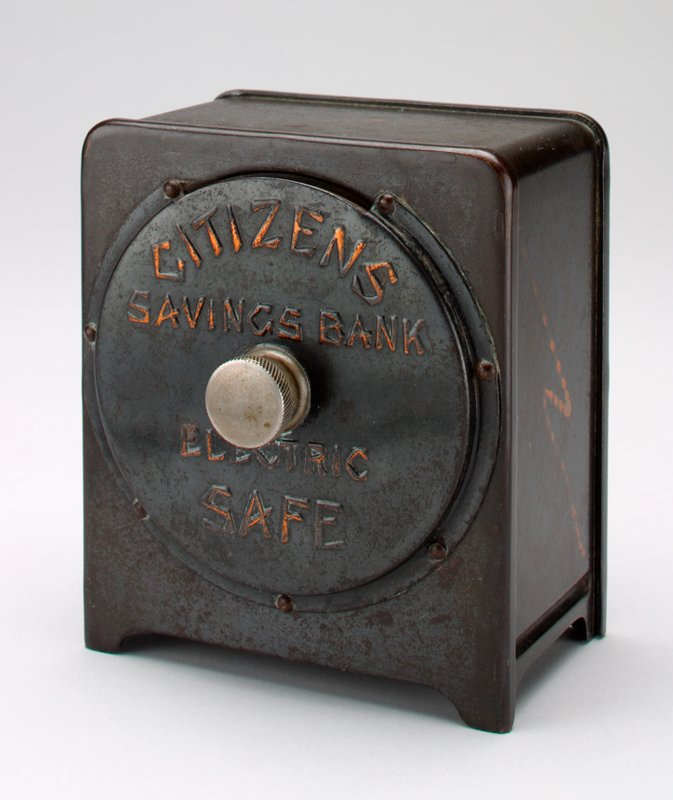 """rectangular metal box safe with dial on front; black with lightening bolts on sides and back; on front is printed: """"Citizens Savings Bank Electric Safe"""""""