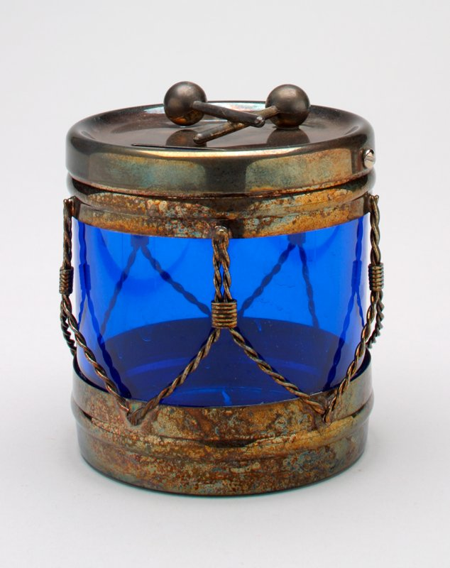 transparent blue plastic drum with silver plated top and bottom and silver plated chain connecting the top and bottom; silver plated drum sticks rest on top