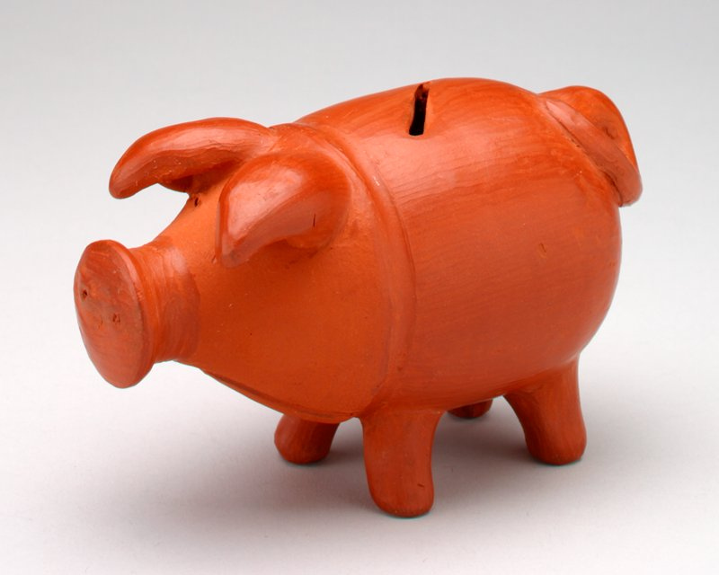 rust ceramic pig; large ears, prominent snout; coin slot in back