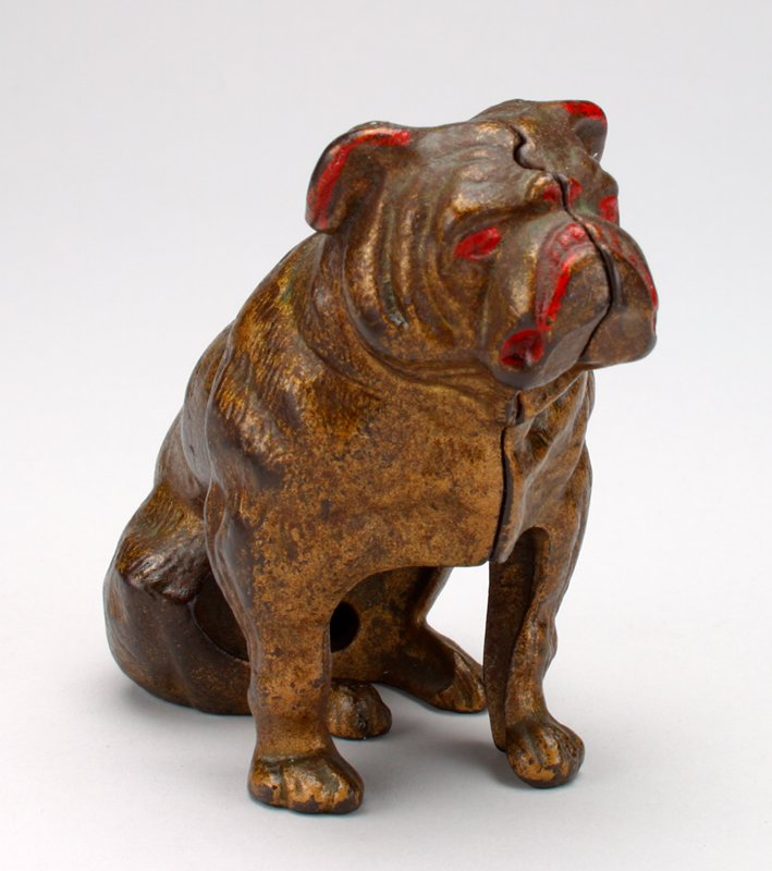 seated bulldog; gold with red at edges of ears, eyes and around mouth; coin slot back of neck