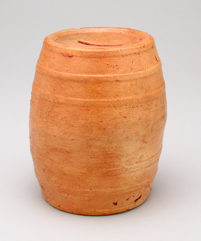 ceramic terra-cotta color barrel; coin slot in top