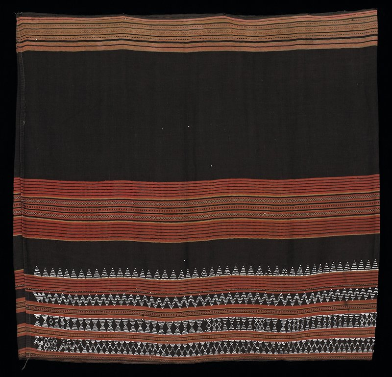black wrapper with red and black striped band at top; larger mid-band of red, black and light stripes; lower band of white beads in various patterns, in between red, black and light striped bands; white beads sewn in various areas overall