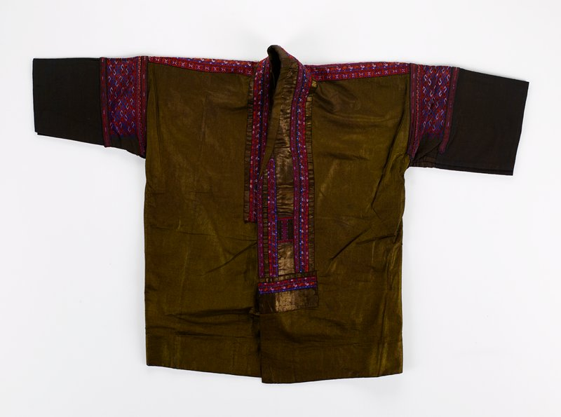 bronze (indigo); open front decorated with brown silk damask, red, white and blue embroidery and woven tape; back is an elaborate pattern of same in vertical and horizontal strips on solid brown damask; yoke and sleeves have same color woven tape; dark brown cuffs; blue lining