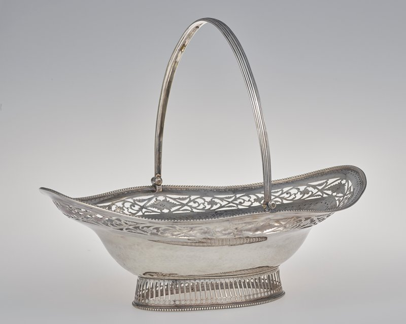 oval body; reticulated pierced foot with beaded edging; threaded movable handle; pierced floral design, engraving and undulating oval beading at top edge