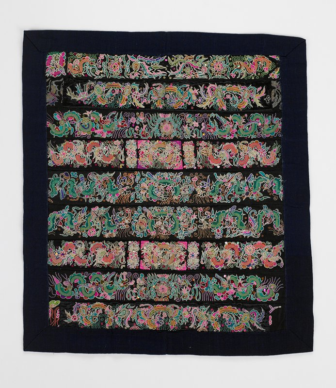 """nine elaborate, horizontal embroidered black bands with fauna and dragons; bright multicolors; blue lining makes 2"""" mitered border"""