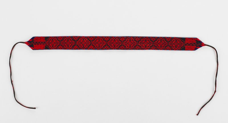 band with ties at each end has 9 embroidered octagonal designs which include other geometric patterns; red and blue on black; lined in black