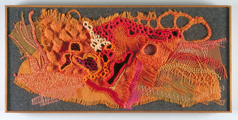 stitchery, appliqué, and cutwork; oranges, reds, magenta, pink, brown, charcoal, and gold on black ground