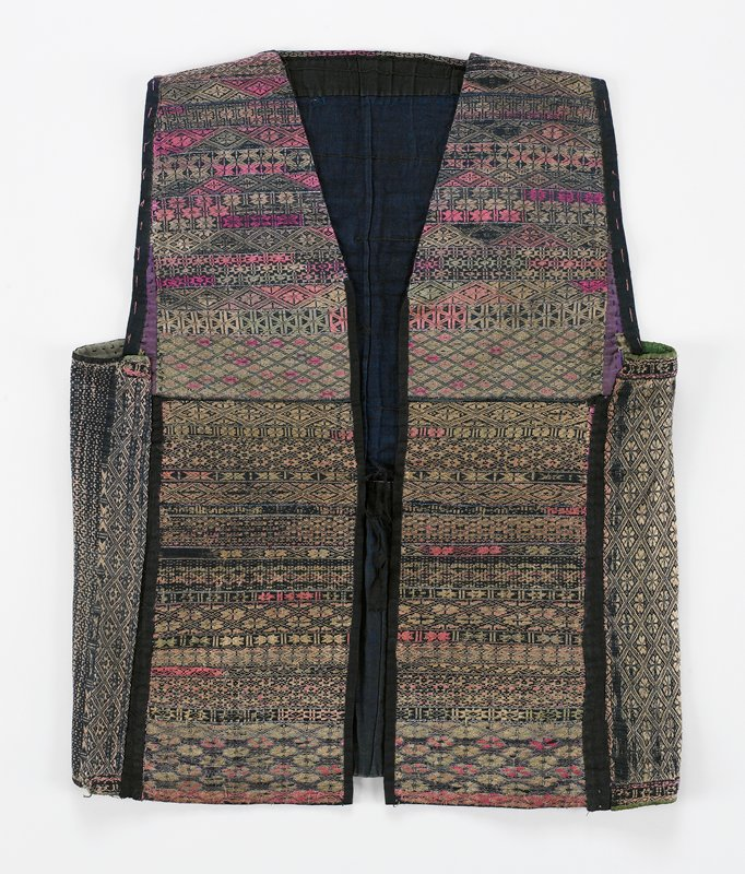 front and back constructed of two sections separated by cording; horizontal geometric embroidery (or woven), various size strips; underarm sections have vertical patterns; fully lined; pink, tan, with blue metallic thread; front ties; black banding and lining