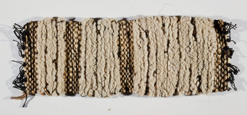wool chenille filler and handspun jute; black and beige