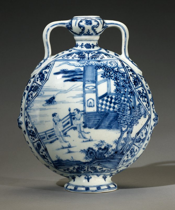 blue and white; flattened globular shape supported on a spreading pedestal foot with flat unglazed base containing a central glazed hemispherical recess; narrow neck flares out to a bulbous mouth supported by a pair of strap handles terminating in ruyi heads on the high schoulders; bulb is painted with a cloud collar filled with scrolls and interspersed with three-petalled motifs; flattened sides are each finely painted with a different pictorial scene within a six-point cartouche, the edges filled with floral sprigs within compartments, and encircled by double lines; one scene comprises two women standing on a terrace outside the open door of a house or pavillion, the right edge framed by rockwork and various trees including pine; beyond a balustrade lies an expanse of water in which splashes a large carp, while fingers of land are visible on the horizon; reverse is painted with two women inside a house or pavillion set in a lush garden of trees, shrubs and a large bamboo on which is perched a phoenix; small boy, waiting on the women, stands at top of the flight of stairs; each narrow side of the vessel is further painted with a floral sprig on the raised boss, itself painted with a flower-head
