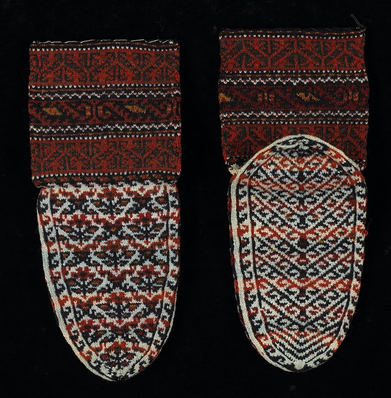 foot has continuous floral pattern; tops--geometric bands; tightly knit; rust, blue, white