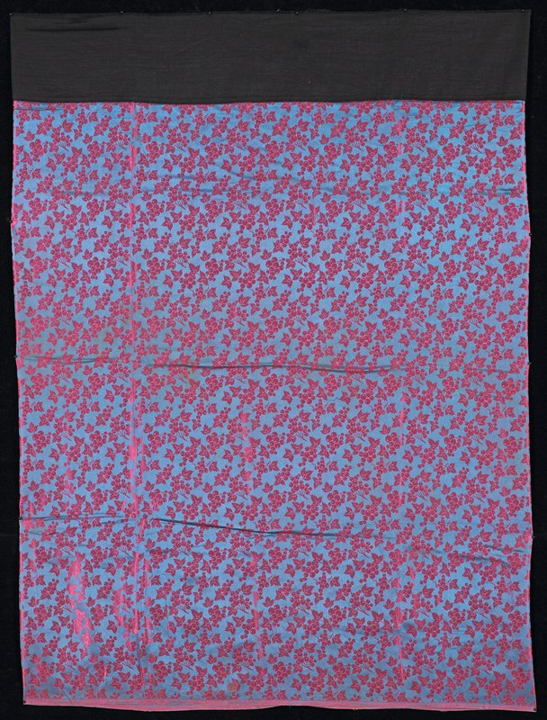 small pattern fruit and leaves of pink on blue; shiny; wide black waistband