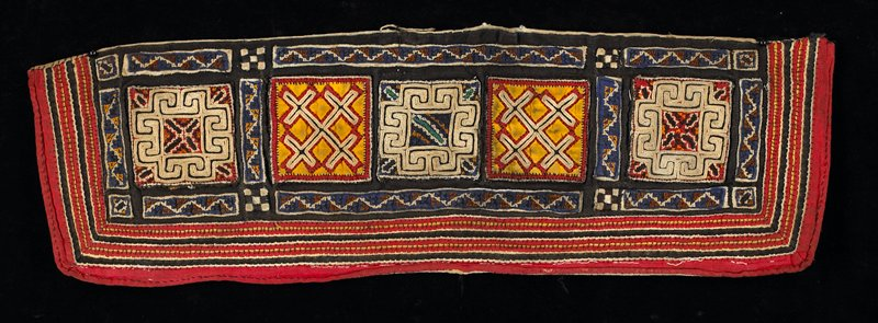 black; primary design is on five appliqued and embroidered squares; various geometric bordered with small strips of appliqued embroidery; red, tan, yellow, blue; off-white lining
