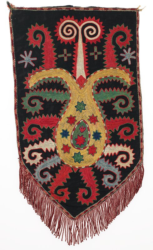 Fringe with plain-weave heading, warp-twined band, Lined. Black cotton ground with polychrome silk embroidery. An applied, patterned woven silk band outlines the edges. A separate silk fringe is sewn to the reverse at the bottom edge. The backing is red cotton.