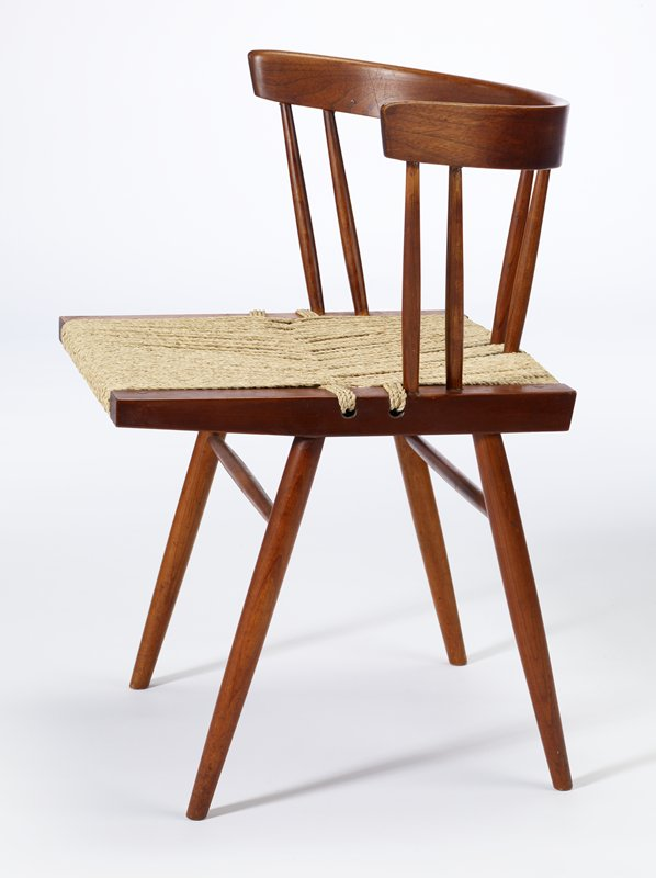back is a curved band of wood with three pairs of vertical rails; square seat with wooden borders and woven seagrass; a horizontal rail connects two back legs and two front legs