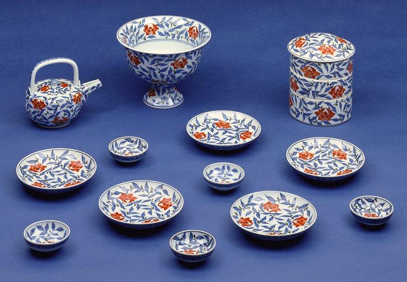 eighteen piece sake, porcelain in peony pattern, underglaze blue with overglaze enamels