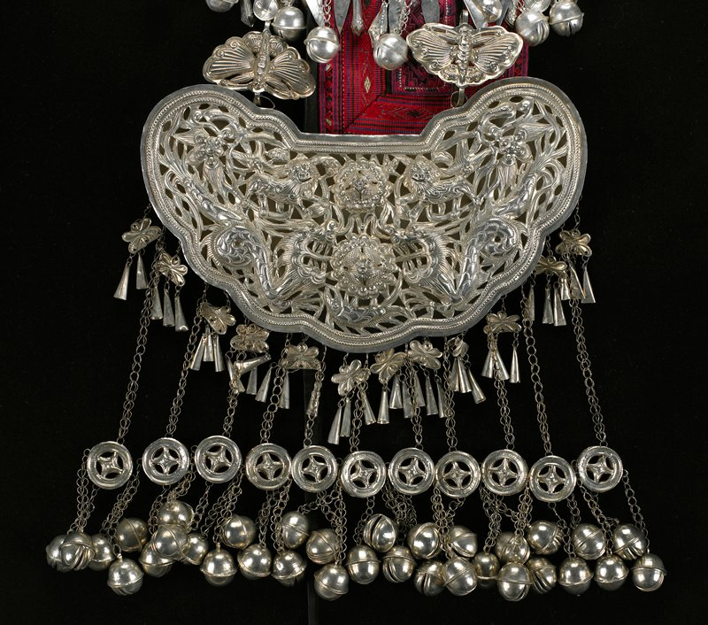 """openwork 3-D """"pendant"""" with pairs of dragons and lions and a fish; double chain with round and floral links attached to top; two top clips with butterfly motifs; long chains with wheel pendants and three bells alternate short chains with floral pendants and bugle beads below large pendant"""