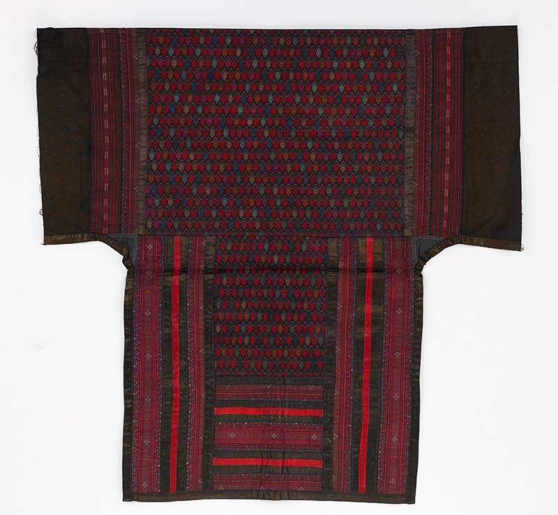 black lined baby carrier; center top and lower center have woven small diamond pattern in dark multicolors; top center and side verticals have applied tape--some in woven pattern; dark red, black, brown, maroon
