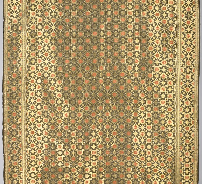 dark olive with floral and geometric metallic gold brocade in overall pattern; borders in same design; orange highlights in flowers; hem facing on bottom edge