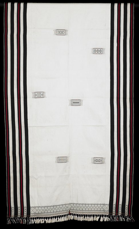 four black stripes run the length near edges; central portion light beige with six small designs, scattered