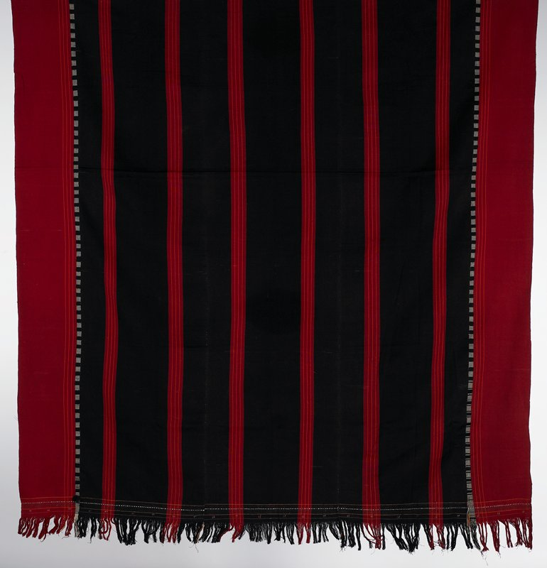 warp face; plain weave; black with red borders and six red stripes running through the length; small patterning and fringe at ends